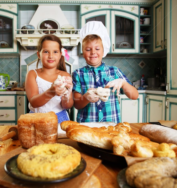 Stock photo: Happy children cooking homemade pastry