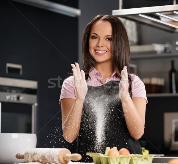 Young woman having fun with flour while making dough on a modern kitchen  Stock photo © Nejron