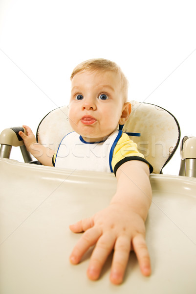 Hungry baby sitting on eating chair isolated on white background Stock photo © Nejron