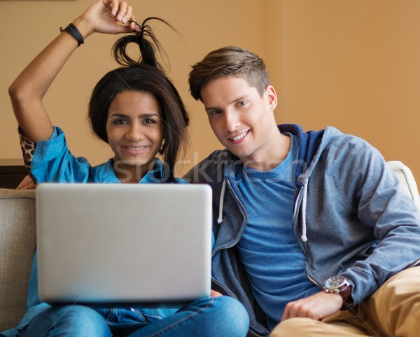 Young multi ethnic students couple preparing for exams in apartment interior  Stock photo © Nejron