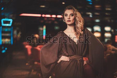 Hermosa rubio mujer vestido de noche sesión bar Foto stock © Nejron