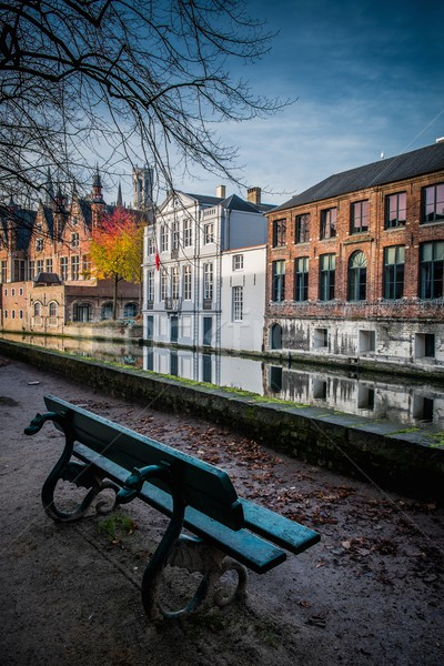Bench near canal in Bruges, Belgium  Stock photo © Nejron