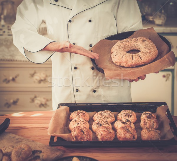 Cook hands holding homemade baked goods Stock photo © Nejron