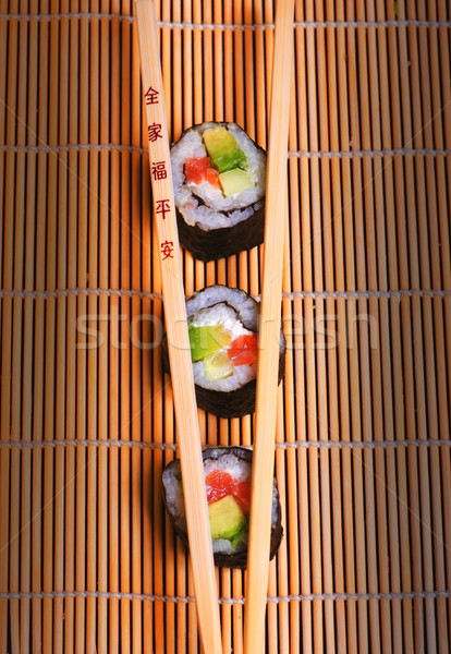 Sushi and wooden chopsticks Stock photo © Nejron