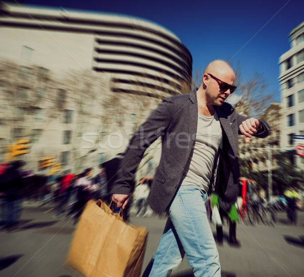 Middle-aged man with shopping bag in a hurry  Stock photo © Nejron