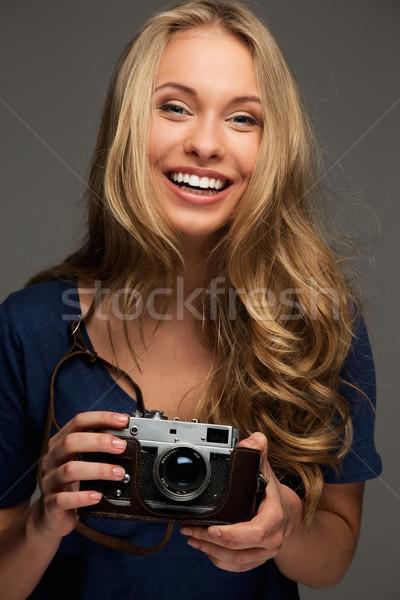 Positif jeune femme cheveux longs yeux bleus vintage Photo stock © Nejron