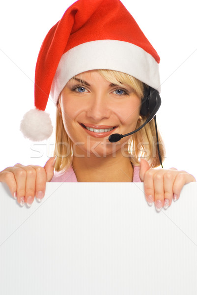 Mrs. Santa with a headset and white noticeboard isolated on whit Stock photo © Nejron