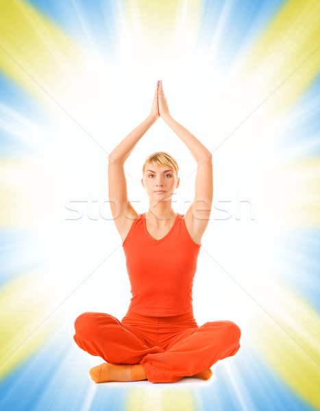 Beautiful young woman doing yoga exercise isolated on abstract b Stock photo © Nejron
