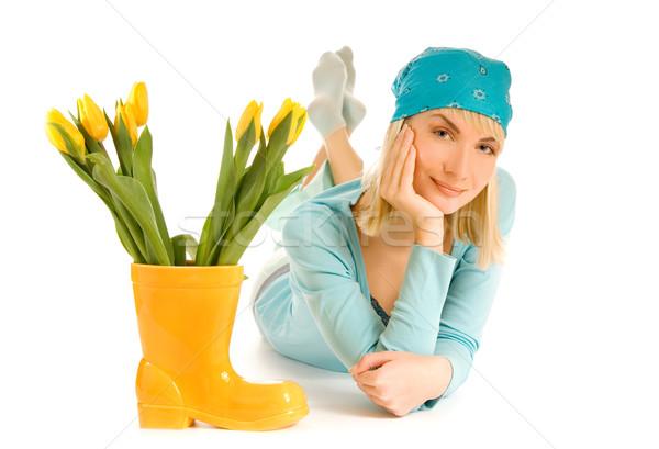 Beautiful teenage girl with yellow tulips isolated on white back Stock photo © Nejron