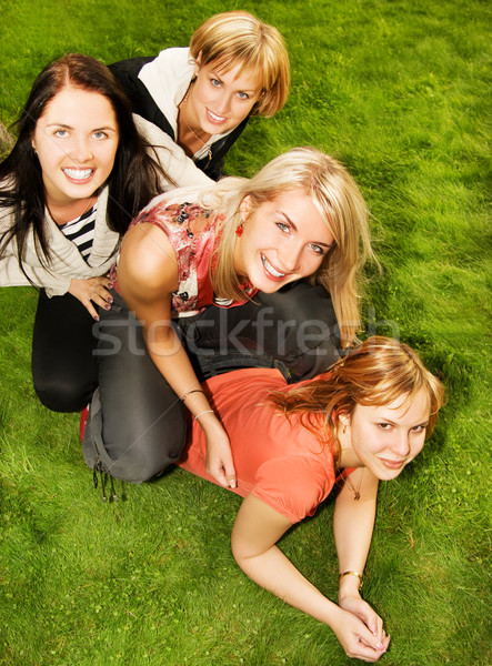 Group of happy friends having fun outdoors Stock photo © Nejron