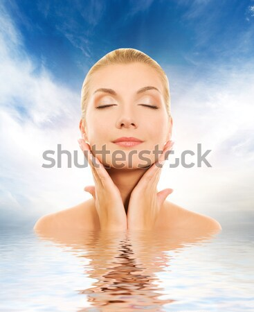 Beautiful young woman with aroma bath ball reflected in water Stock photo © Nejron