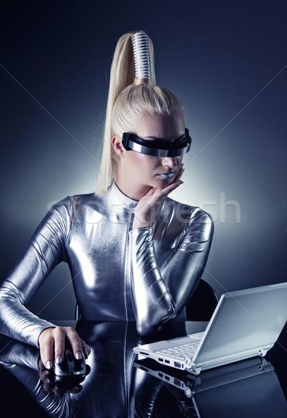 Güzel kadın çalışma dizüstü bilgisayar yüz dizayn Stok fotoğraf © Nejron