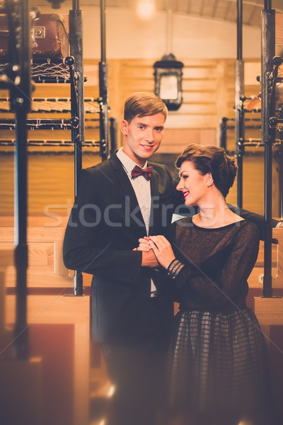 Beautiful vintage style couple inside retro train coach  Stock photo © Nejron