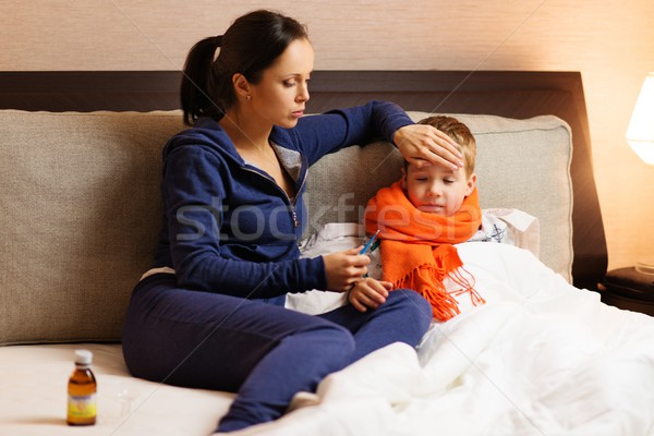 Young mother and her sick son in a bed Stock photo © Nejron
