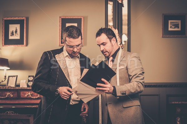 Tailor and client choosing cloth for custom made suit  Stock photo © Nejron