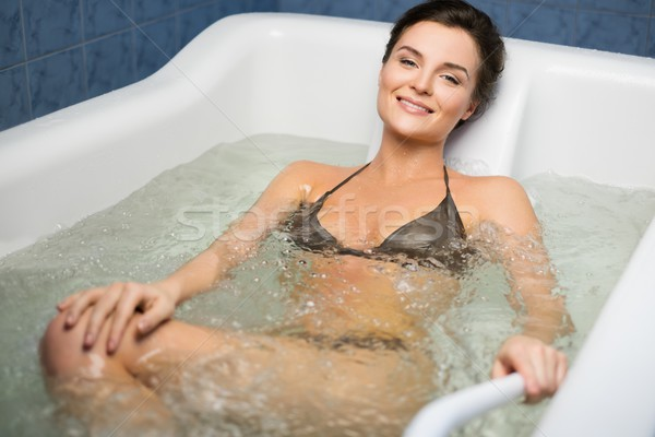 Woman having procedure in a  bathtub  Stock photo © Nejron