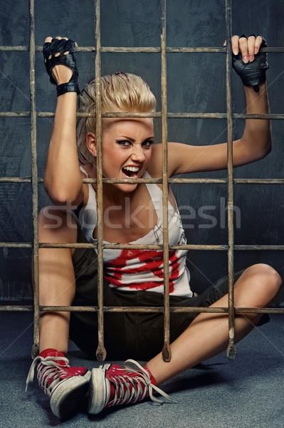 Punk girl behind bars Stock photo © Nejron