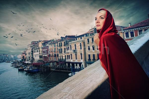 Nő piros köpeny híd épület város Stock fotó © Nejron