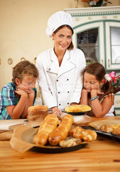 Mother cook with her little children preparing homemade pastry Stock photo © Nejron