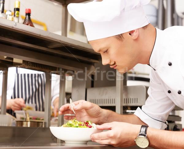 Genç pişirmek gurme gıda mutfak restoran Stok fotoğraf © Nejron