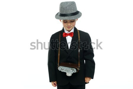 Little boy in hat and black suit with vintage camera isolated on white background  Stock photo © Nejron