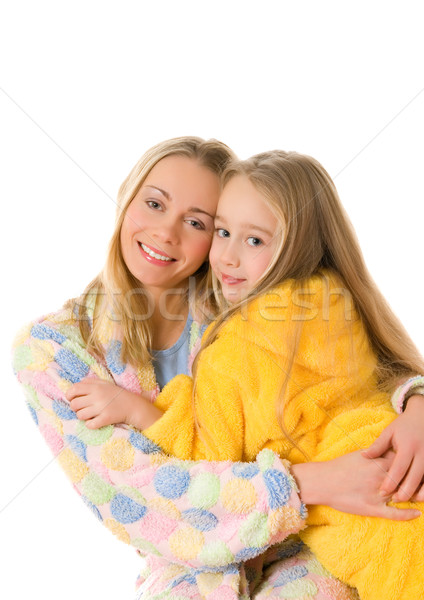 Mother and her daughter in colorful bathrobes Stock photo © Nejron