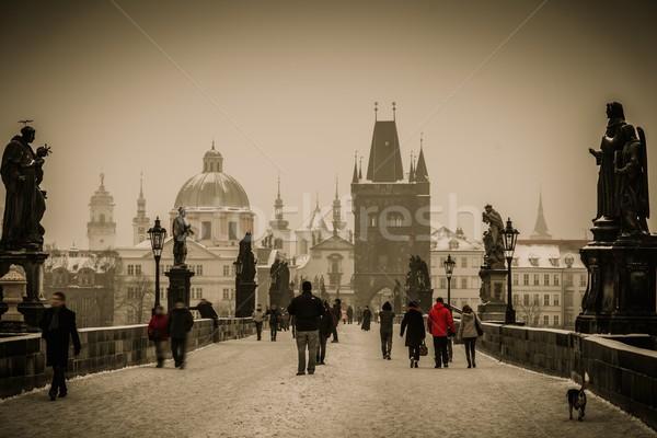 People walking on a Charles bridge in Prague Stock photo © Nejron