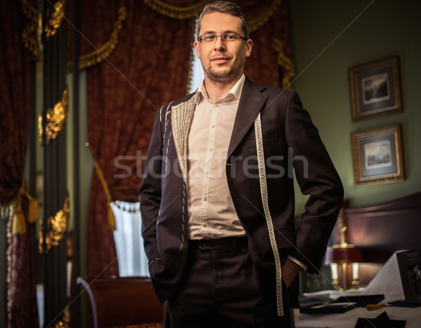 Middle-aged man trying on custom made suit in luxury vintage interior  Stock photo © Nejron