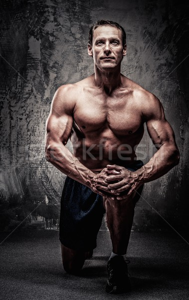 Middle-aged muscular sportsman on his knee Stock photo © Nejron