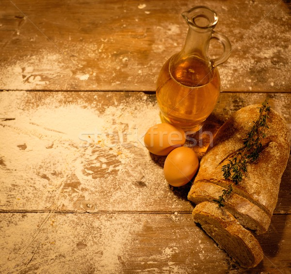 Homemade bread, oil and eggs on a table  Stock photo © Nejron