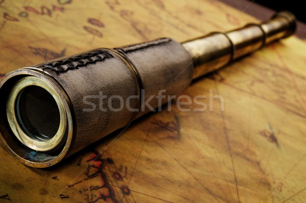 Close-up of a spyglass on the old map Stock photo © Nejron