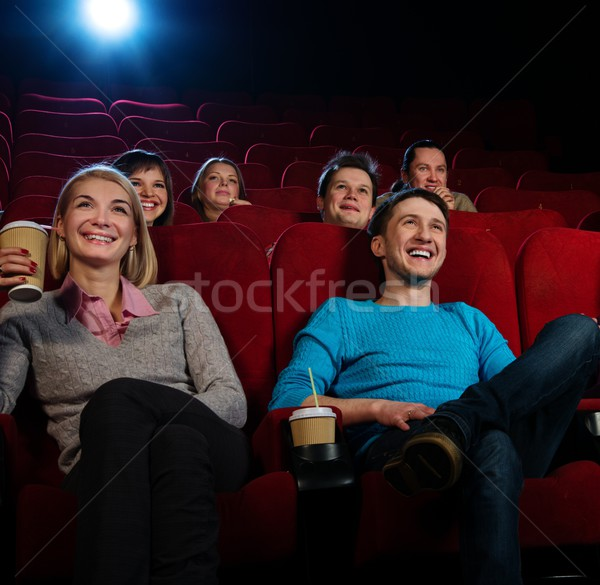 Group of smiling people watching movie in cinema Stock photo © Nejron