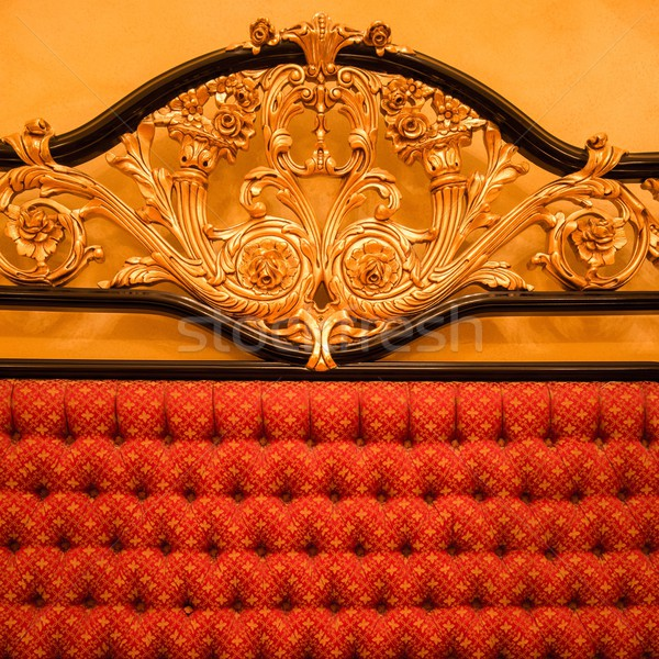 Back of expensive sofa with golden ornament Stock photo © Nejron