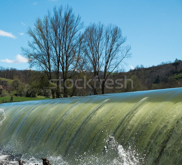 Weirs on river on a beautiful day Stock photo © Nejron