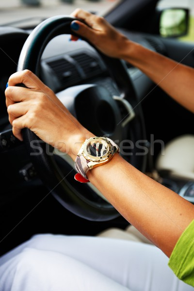 Woman hands on a steering wheel Stock photo © Nejron