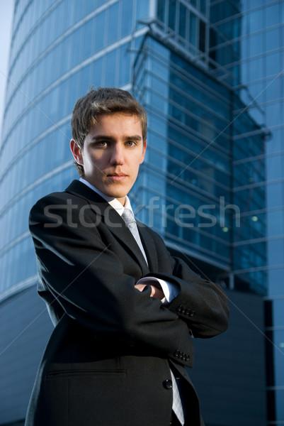 Jovem homem de negócios posando prédio comercial negócio modelo Foto stock © Nejron