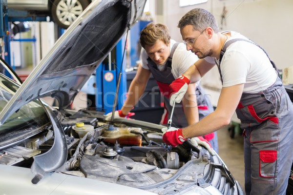 Two mechanic fixing car in a workshop Stock photo © Nejron
