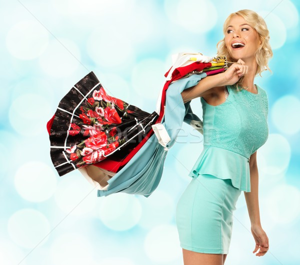 Smiling blond woman with different clothes over blurred background  Stock photo © Nejron