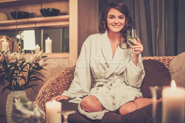 Beautiful woman relaxing in a bathrobe in spa salon  Stock photo © Nejron