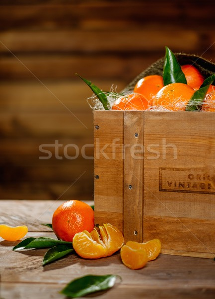 Wooden crate with tasty tangerines on a table  Stock photo © Nejron