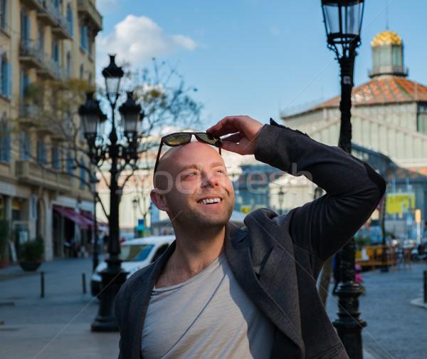 Smiling middle-aged man wearing jacket outdoors Stock photo © Nejron