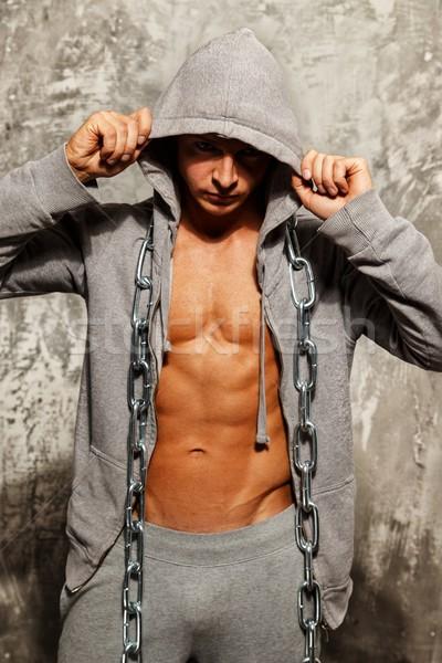 Muscular homem cinza heavy metal cadeia Foto stock © Nejron