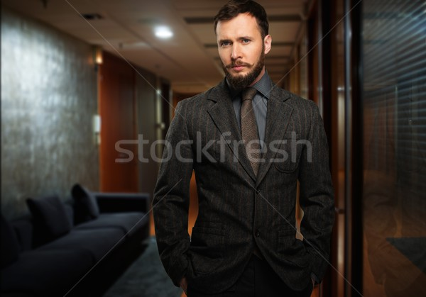 Handsome well-dressed man with beard in a hallway Stock photo © Nejron