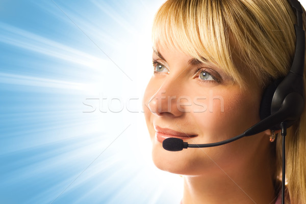 Friendly hotline operator over abstract blue background Stock photo © Nejron