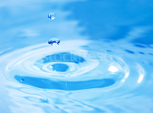 Droplets falling in blue water Stock photo © Nejron