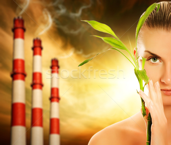 Young woman with green plant. Global warming concept Stock photo © Nejron