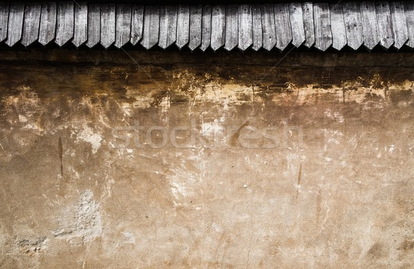 Old stone wall with wooden roof tile Stock photo © Nejron