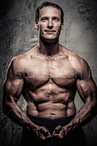 中年 男子 強健的身體 運動 健身 行使 商業照片 © Nejron