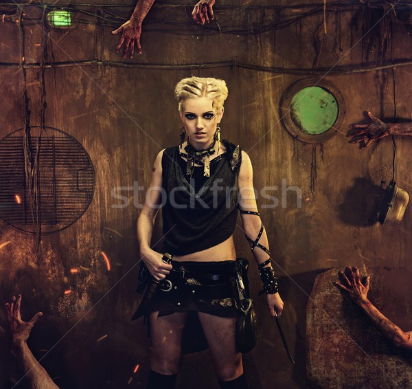 Woman in a bunker with zombie hands around her Stock photo © Nejron