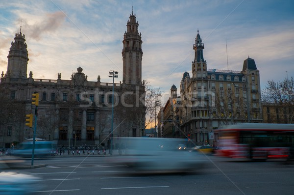 Fast moving cars against postal and telegraph building in Barcelona Stock photo © Nejron
